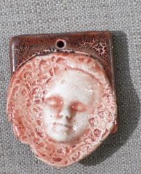 Art: facial bead pendant by Artist Deborah Sprague