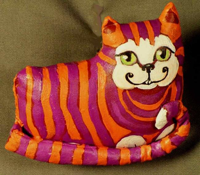 cheshire cat 2010. Art: The Cheshire Cat by