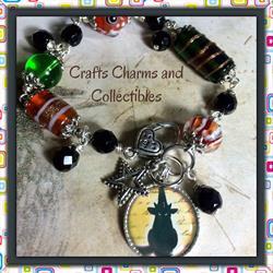 Art: Black Cat, altered art charm bracelet by Artist Lisa  Wiktorek