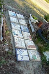 Art: laying pavers in garden by Artist Naquaiya
