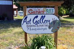 Art: sign and garden art by Artist Naquaiya