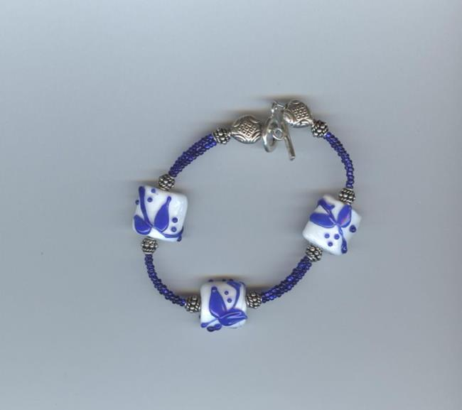 Art: Blue and white bracelet by Artist pamela jean lacasse