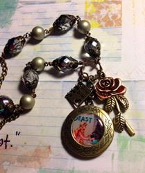 Art: Beauty and the Beast Altered Art charm necklace by Artist Lisa  Wiktorek
