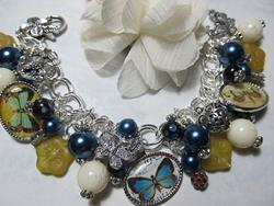 Art: Butterfly Splendor Charm Bracelet Altered Art One of a kind by Artist Lisa  Wiktorek