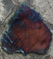 Art: Raku Sunflower Leaf by Artist Deborah Sprague