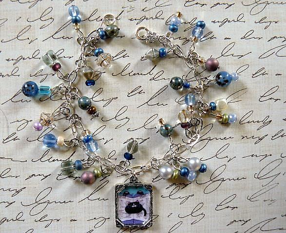Art: newspaper cat charm bracelet by Artist S. Olga Linville