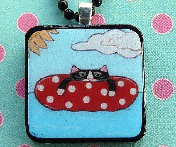 Art: inner tube cat art pendant by Artist S. Olga Linville