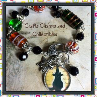 Art: Black Cat, altered art charm bracelet by Artist Lisa  Wiktorek