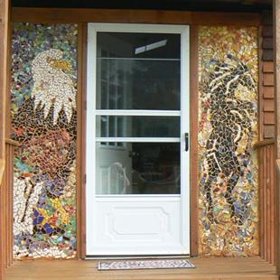 Art: mosaic panels by front door of cottage by Artist Naquaiya