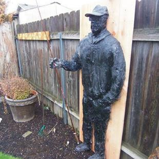 Art: Fisherman in fiberglass by Artist Leonard G. Collins